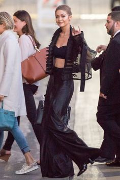 Gigi Hadid attends a Victoria's Secret fitting wearing wide-legged trousers, a bralette and a sheer black jacket. See more style inspiration: http://www.harpersbazaar.co.uk/fashion/style-files/news/g37359/best-dressed-this-week-7-november/