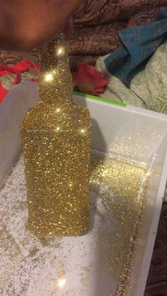 I used an old Jack Daniel's bottle and added glitter using Elmer's multipurpose spray adhesive