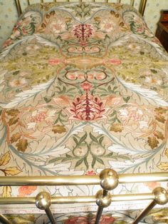 'Acanthus' Embroidered Bed Cover, c.1890. Perhaps made by May Morris (William Morris' daughter) who began working for Morris & Co in 1885. May's workbooks record many requests for this design. Stored in darkness for a century, it has been well preserved. Although covering the beds during the day, bed covers were folded away at night & the family slept under 'whitework' covers. In 1877 this cover could have cost £ 100. #William_Morris #Morris_and_Co #embroidery #May_Morris