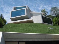 Villa Am See 24 Architecturally Striking Concrete Home with Views of the Swiss Alps