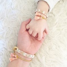 """Peach tribal mom bracelet with gold chainPeach tribal mini version braceletWith gold claspsTwo matching gold bead tassel bracelet in adult and mini to match with peach tasselsStandard adult measures 7.5""""Turn around shipping will be 4-5 weeks!!!! Please plan accordingly.Please leave age or size measurements of the mini little version in the notes! Can be newborn up to"""