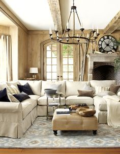 Warm, Neutral Living Room from Ballard Designs. I like the feel of the room but don't like the skirts on couches.