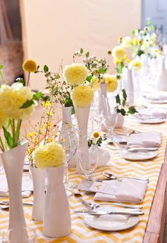Wedding decorations - mismatched vases and yellow flowers