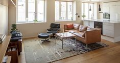 URBAN Slate Gray hand tufted rug underlines the Mid-century inspired style of the city apartment. Bauhaus Textiles, Hand Tufted Rugs, Sitting Area, Textile Design, Slate, Mid Century, Urban, Grey, Table
