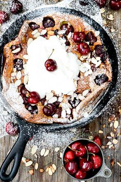 Bourbon-Cherry and Almond Dutch Baby by Floating Kitchen on foodiecrush.com