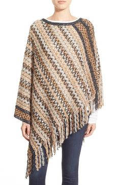 Free shipping and returns on Missoni Zigzag Poncho at Nordstrom.com. A sweeping fringe lends subtle movement to an elegantly draped poncho in a stunning signature zigzag pattern—for a cold-weather look with a hint of vintage sophistication.