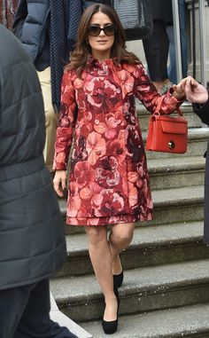 Salma Hayek from Stars at Milan Fashion Week Fall 2015  Always one to arrive in style, the actress hits up the Giamba show in a floral, muted-rose coat and oversized shades.