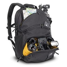 """Got it: Awesome backpack with padded dividers for camera equipment and a 16.5"""" long laptop compartment. Newer model's about $100; older one is abt $60. Needs to fit 2012 15"""" Macbook."""