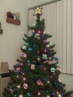 Super Mario Bros. Perler Bead Star Christmas Tree Topper. $20.00, via Etsy.