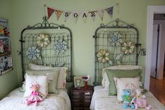 From the Bachman's 2012 Spring Ideas House... such a cute bedroom. love the repurposed gate headboards