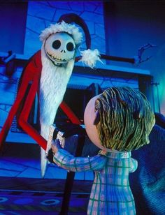 *SANTA JACK ~ The Nightmare before Christmas, 1993...Santa Jack gifting a head to a little boy.