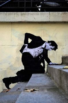 Paste up urban art by French artist Levalet in Paris, France