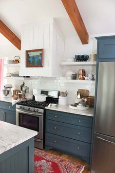 Shiplap hood with dark green cabinets and persian rug #kitchen