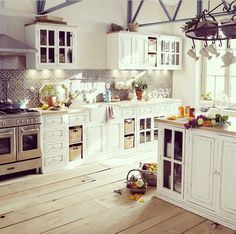 This white and light kitchen is beautiful.