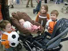 Family Halloween costume: Sports theme. Soccer ball, baseball, football and basketball costumes. There's even a mitt costume for the stroller!