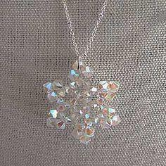 Swarovski snowflake necklace by DonnaCDesigns Swarovski Snowflake, Snowflake Jewelry, Bead Crafts, Jewelry Crafts, Handmade Jewelry, Beaded Jewelry Patterns, Beading Patterns, Bijoux Wire Wrap, Bead Jewellery