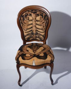 "You may not normally think much about your spine, rib cage, and pelvic bones when you sit in an ordinary chair, but Sam Edkins' ""Anatomically Correct"" seats are more than ordinary. These chairs combine Victorian furniture design with human skeletons and circulation, creating a whimsical object."