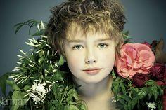 Boy in a flower scarf
