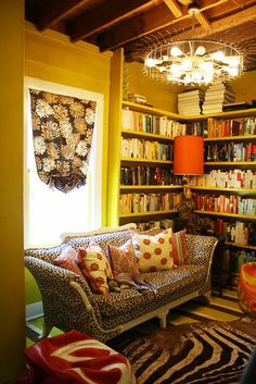adorable mini library. and check out that light fixture! awesome!