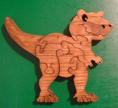 Wood Puzzle  Goofy T-Rex dinosaur Hand cut on Scroll saw. $8.00, via Etsy.