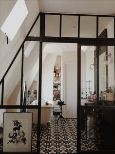 Nadine & Matthieu's Stylish Duplex Apartment in Paris. Glass door, bathroom, pattern tiles