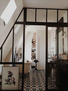 Nadine & Matthieu's Stylish Duplex Apartment in Paris. Glass door, bathroom, pattern tiles