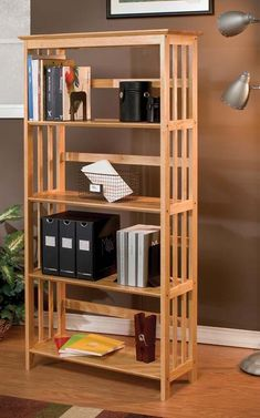 Practical solid wood bookshelves provide endless storage in any home. This lovely, mission-inspired piece features clean lines and is constructed of Asian hardwood for durability. It works well in any style of decor, from rustic to modern.
