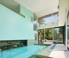 Modern Indoor Pool  Sky-high windows and sliding glass doors make the pool seem like it's outside.