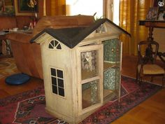 Repurposing cabinet into dollhouse