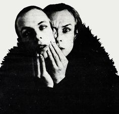 Brian Eno doing the mask thing, quite Bowie-ish