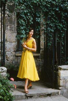 Anne Gunning wearing a yellow dress, 1955.