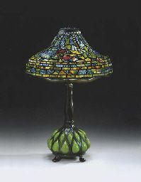A 'JEWELED CARP' LEADED GLASS, BLOWN GLASS AND RETICULATED BRONZE TABLE LAMP  TIFFANY STUDIOS, CIRCA 1900