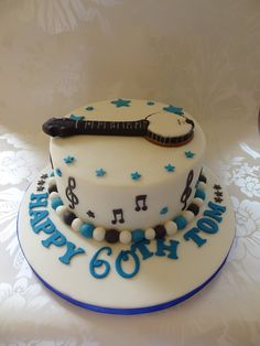 Rachels Enchanting Creations - birthday cake with Banjo on top complimented with music notes x