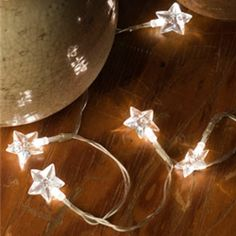 Lights for all Occasions - 20 Warm White Rice String Light Stars, Silver Wire, Battery Operated