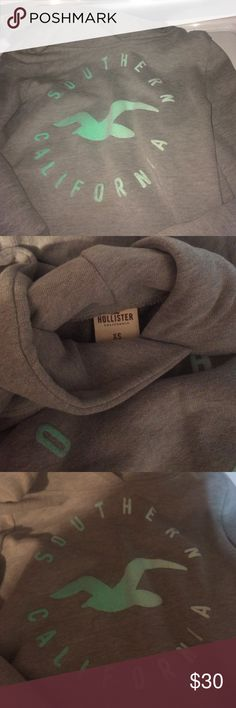 Hollister Hoodie 60% cotton 40%polyester wore once. Says SOUTHERN CALIFORNIA on front in soft bubble letters with the Hollister logo. There isn't any fades or staining there's a shadow on the picture I took! Hollister Tops Sweatshirts & Hoodies