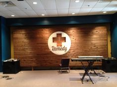 Stage design cutout over pallet wall.