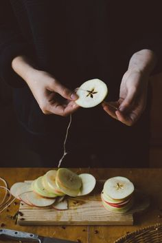 How To Decorate for Christmas With Only a Trip to the Grocery Store | Apartment Therapy: Apples aren't only for pies and keeping the doctor away. You can cut them into slices, thread string through the core and adorn your fireplace mantel with a festive garland. Babes in Boyland did this in order to hang and dry their apple slices before eating them, but you can use them for decorating and they'll be just as sweet.