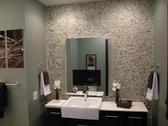 Fantastic Bathroom Makeovers: Everything about this bathroom is modern from the TV mirror to the pebble tile wall and the floating vanity to the eco-friendly elements and artwork. Description from pinterest.com. I searched for this on bing.com/images