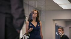 """WOOOOOOOOOAH this website catalogues all the clothes worn by celebrities! apparently this dress is Narciso Rodriguez Resort 2010. and she works it flawlessly, with understated gold jewelry and badass demeanor. Hilarie Burton (Sara Ellis) in a scene from WHITE COLLAR, episode 2.06 """"In the Red""""."""