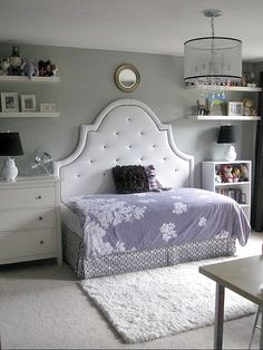 Full headboard with a twin mattress/frame turned longways: a brilliant way to save space in a small room