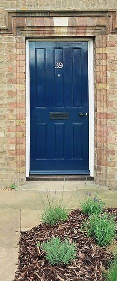 Navy front doors on pinterest red brick houses red for Navy blue front door