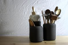 This modern set of containers are great for kitchen storage. Together their minimal design and simple shapes create a work of art for you and