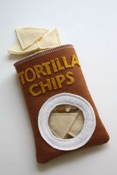 Make a brown bag for tortilla chips I made for the Mexican restaurant that rolls closed with Velcro to use in grocery store.
