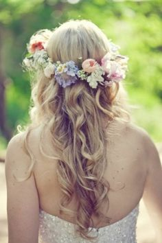 Bohemian Wedding Hairstyle. Best with long flowing hair, either straight or curly. This is a simple, fresh look suitable for outdoor or garden wedding ceremonies. You can accessorize with flower crowns, jewels, or simple veil. You can also wear this style for indoor wedding ceremonies.