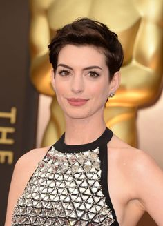 Hathaway proves that the pixie can be feminine and flattering—the windswept longer layers on top up the glam factor.