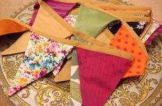 Bright and colourful bunting made using our fabrics by Studio Undiscover check them out on facebook https://www.facebook.com/studioundiscovered