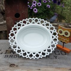 Doric Open Lace Milk Glass Oval Bowl - Wedding Centerpiece - Oak Hill Vintage  This is the most beautiful white milk glass bowl, love the pattern of the open lace. The smooth bowl is edged with double rows of lacy scalloped trim. Would make a gorgeous centerpiece full flowers. Perfect piece to add to a candy buffet table.  It measures about 3 tall, 8 3/4 long, 7 1/4 wide acand 4 1/4. This bowl is in good vintage condition with no cracks but a few rough edges on the base. It is ...