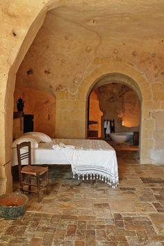 Sextantio Le Grotte Della Civita - Matera, Italy - There are rickety dark brown…