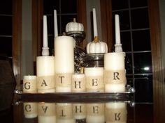 burlap wraps on candles. would be pretty for Christmas candles too