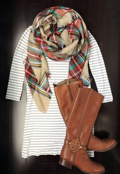 Blanket scarf, striped dress, and riding boots